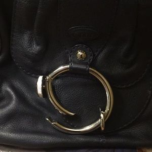 Never used tods bag with dust bag